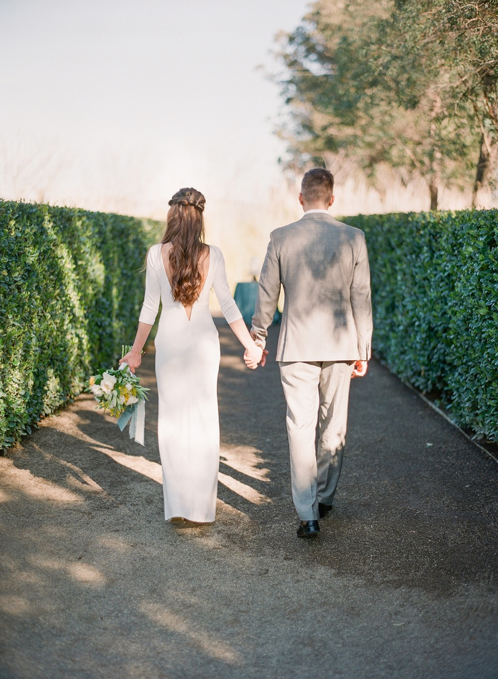 wedding couple walking hand in hand