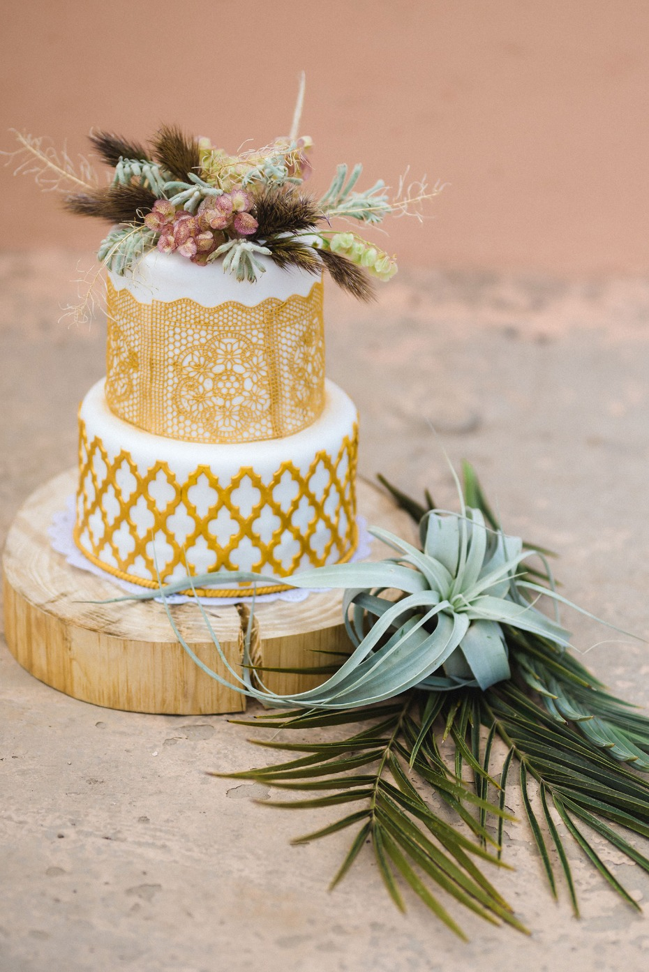 gold cake with air plant