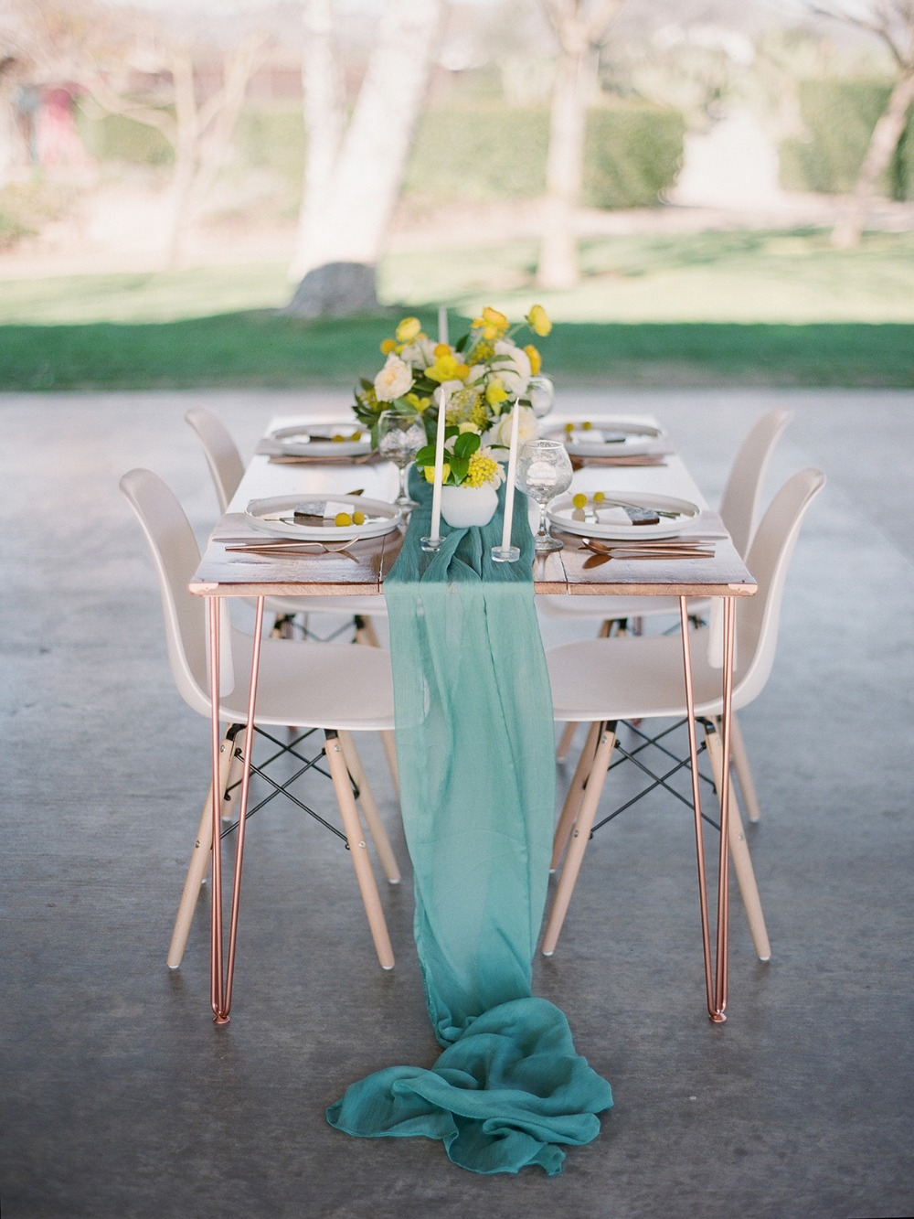 teal and yellow wedding table with a fun modern vibe
