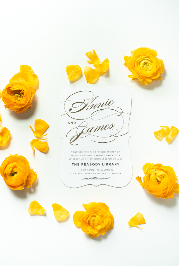 Gold foil and the flower petals to match. This dreamy golden wedding invitation has us swooning!