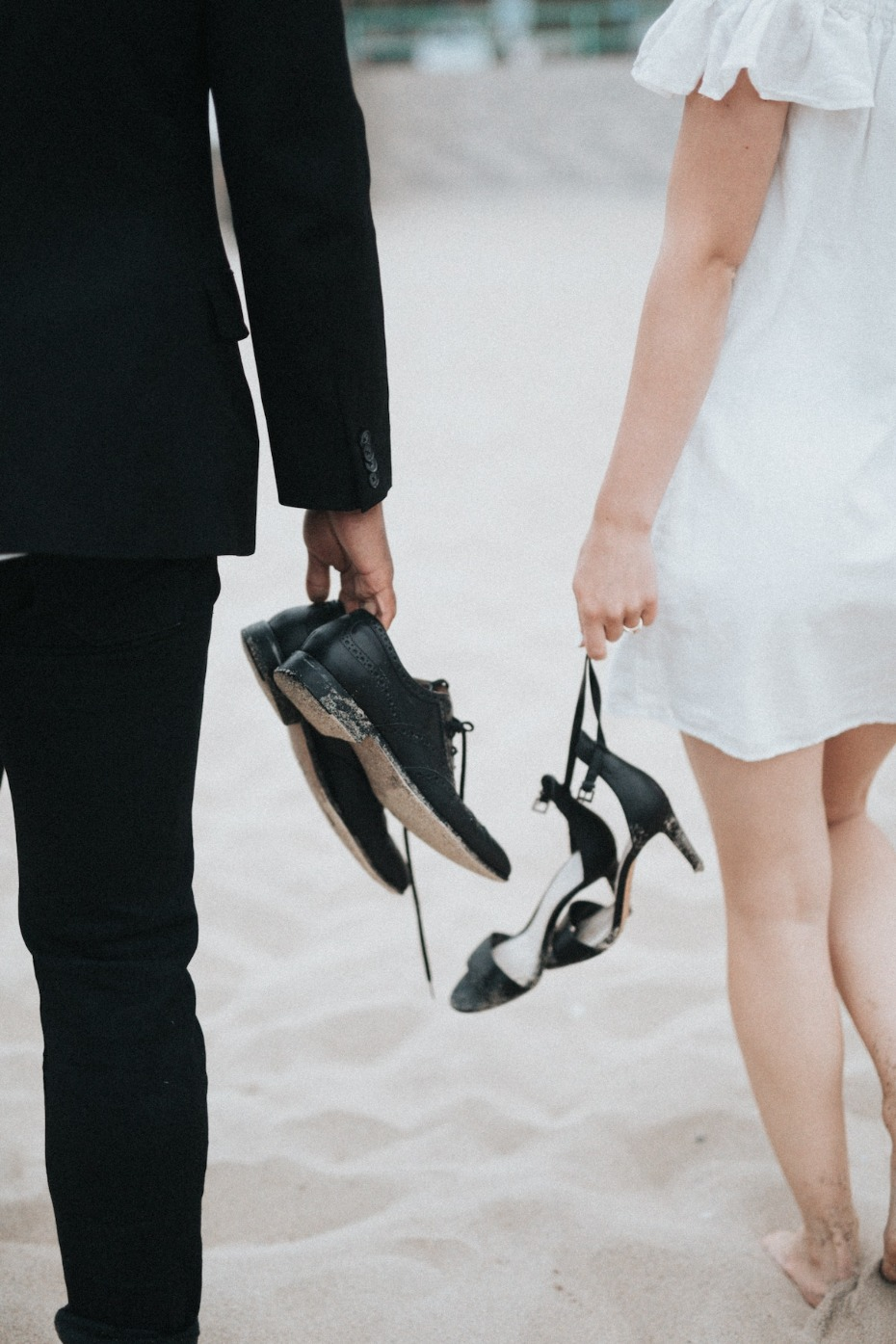 Bride and groom barefoot on the beach