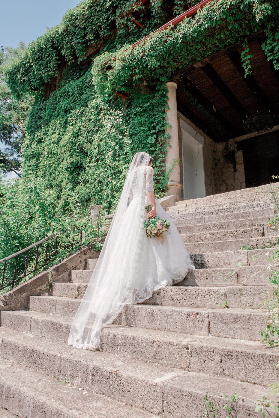 Bride ascending steps into ceremony