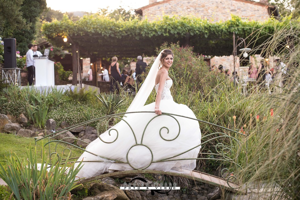 Such a beautiful bride! On the background: the grapes on pergolas of a tuscan hamlet.