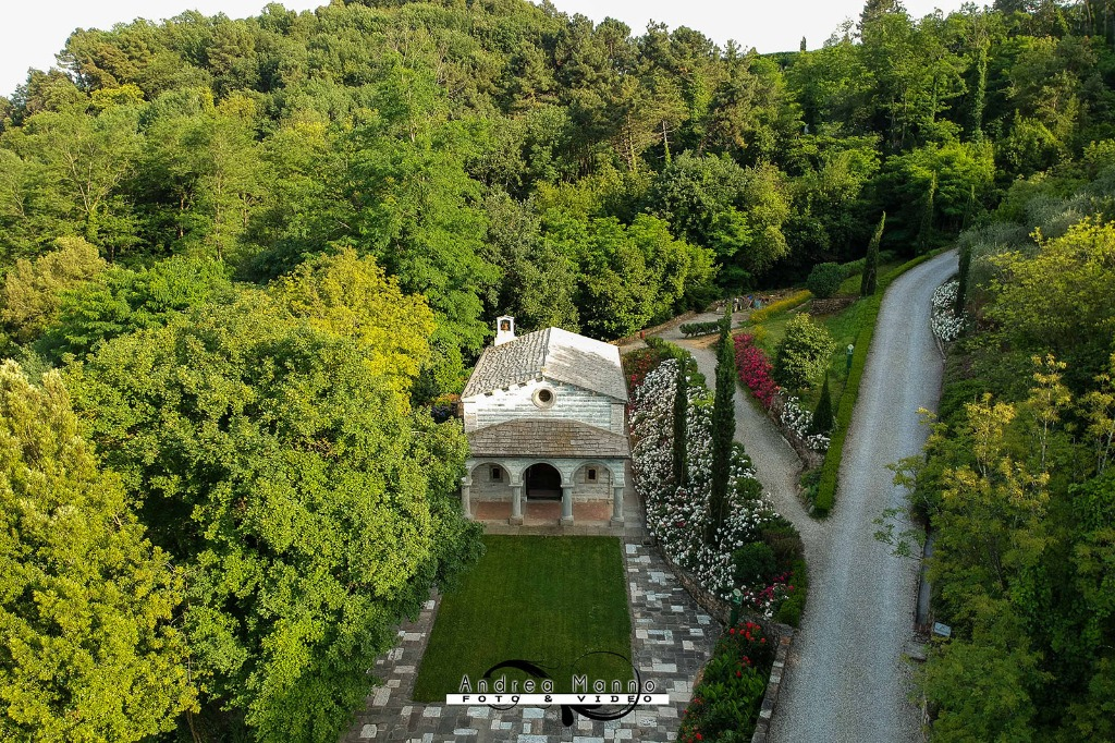 A small tuscan church surrounded by the astonishing nature of a private park.