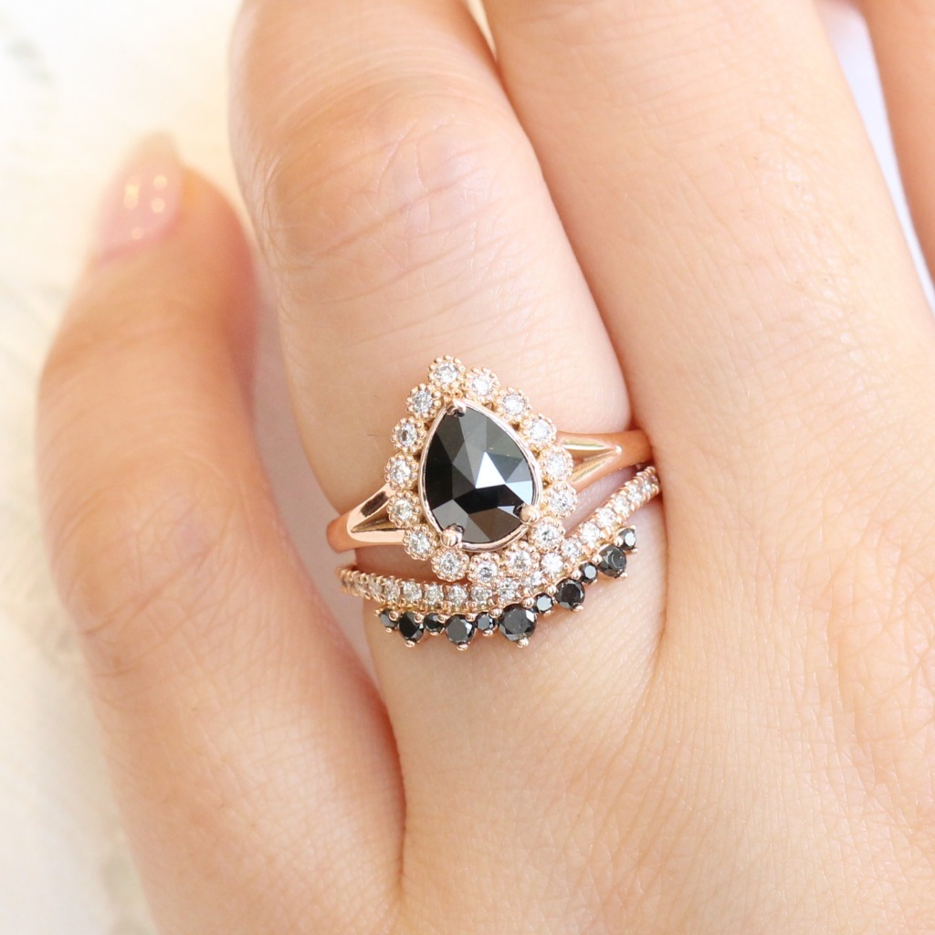 Vintage inspired rose cut black diamond engagement ring in rose gold nesting gorgeously with a black and white diamond crown wedding