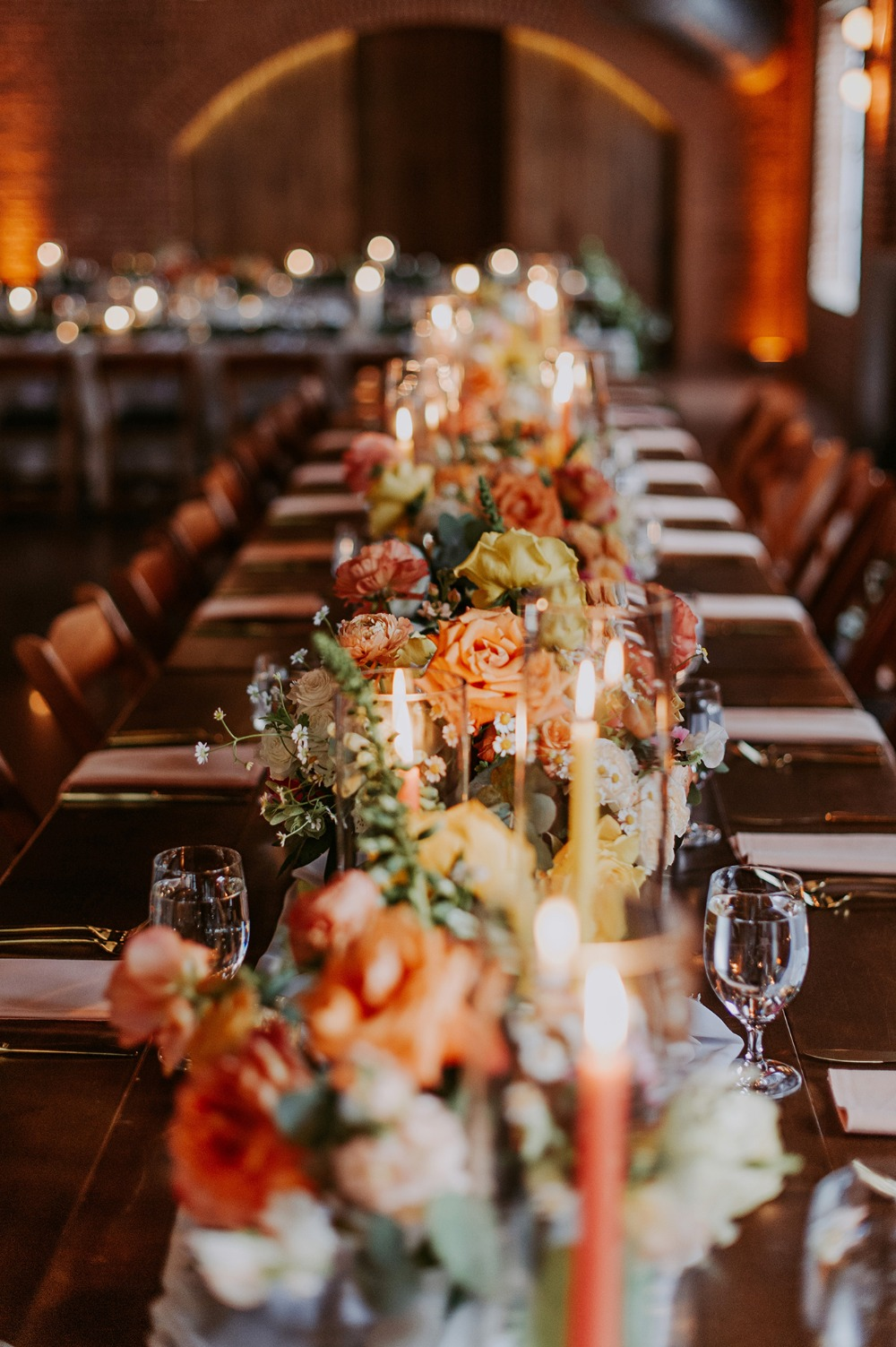 bright orange wedding floral centerpiece