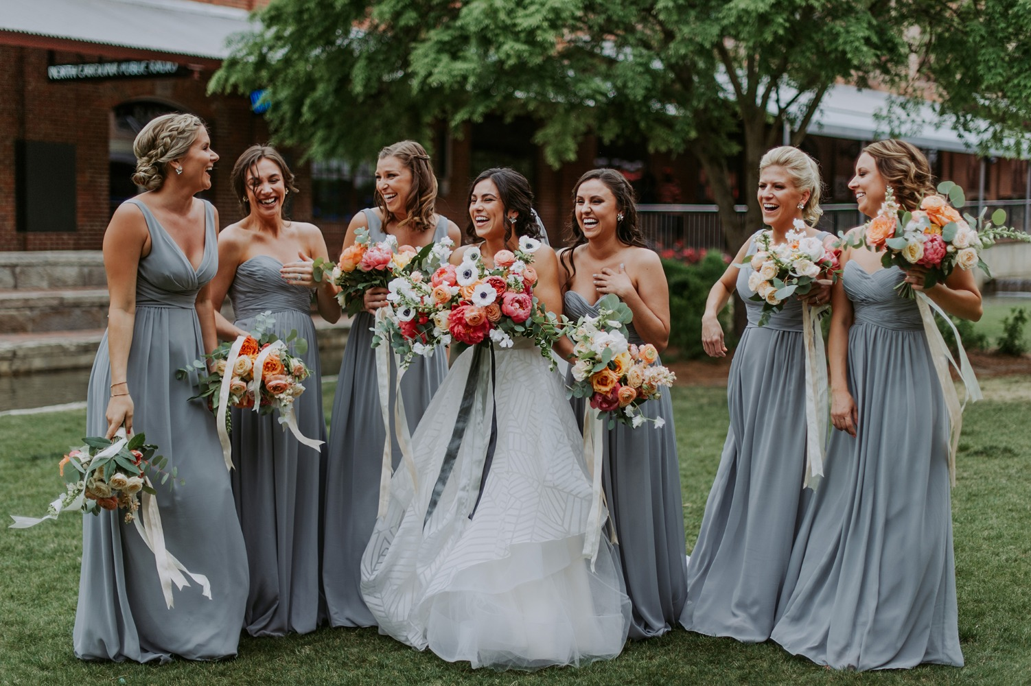bridesmaids in soft blue grey dresses