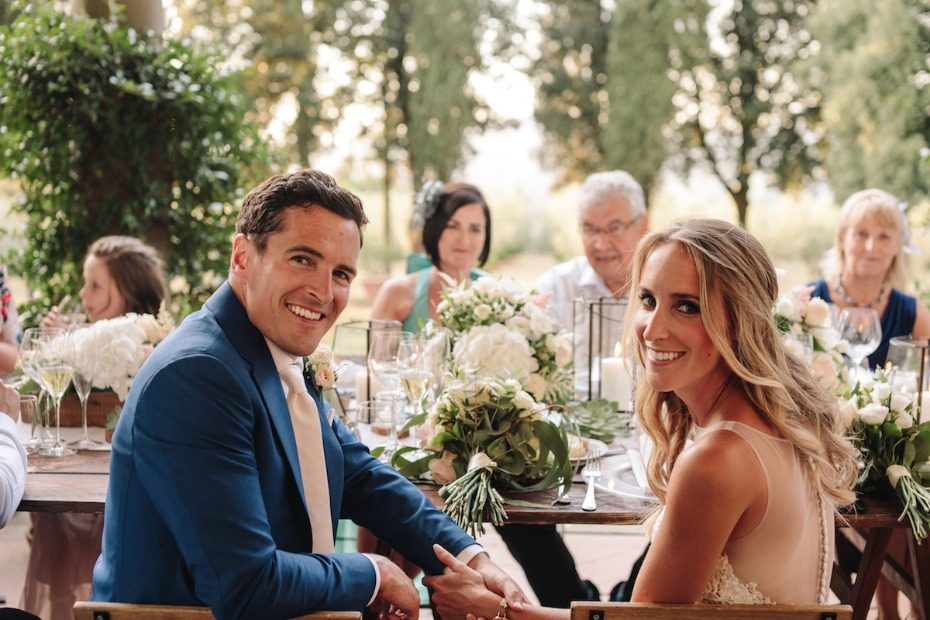 Couple smiling at wedding reception in Tuscany Italy Planned by Wed in Florence
