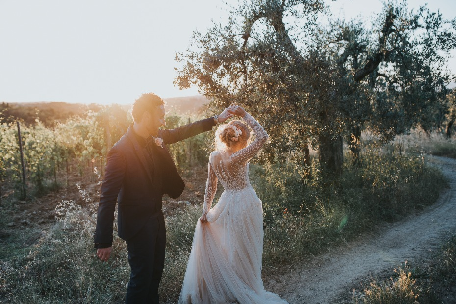 Bride and groom twirling in Tuscany Italy Planned by Wed in Florence