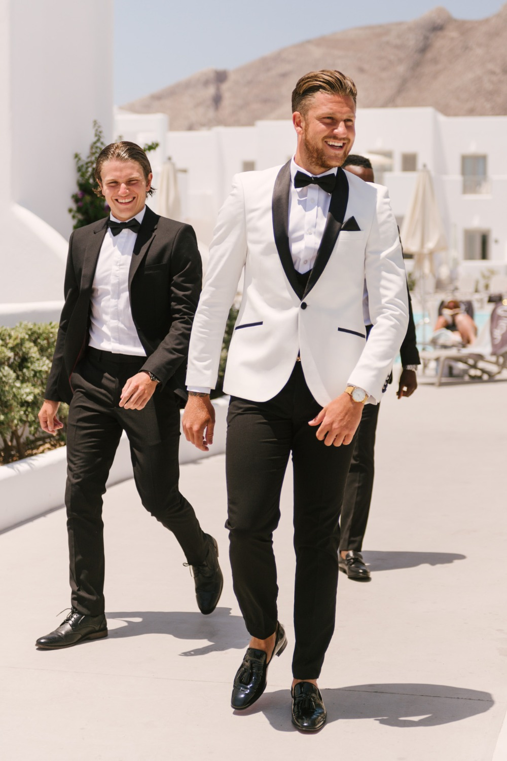 groom in white and black