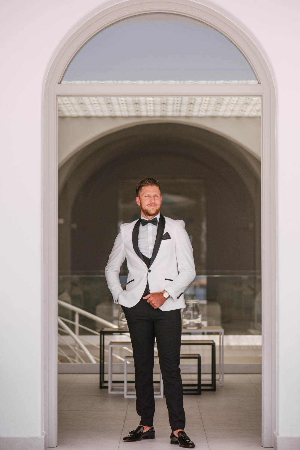 groom in stylish black and white