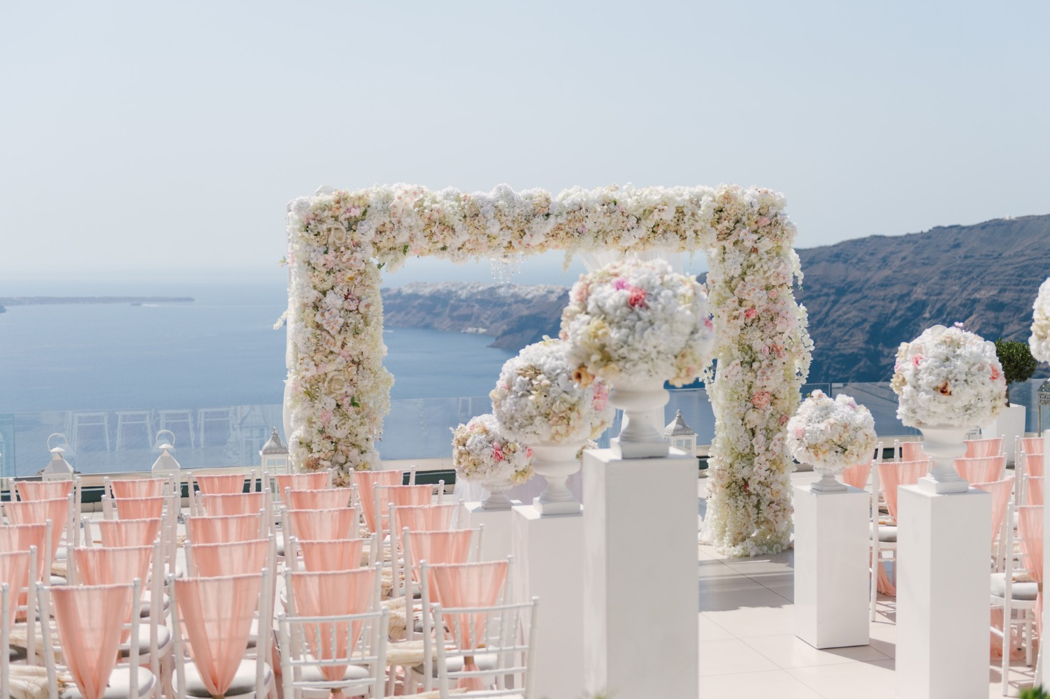 white and pink wedding ceremony decor