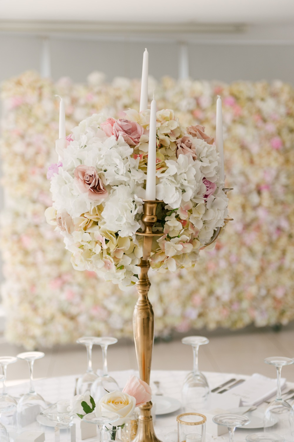 white and pink floral accented candelabra