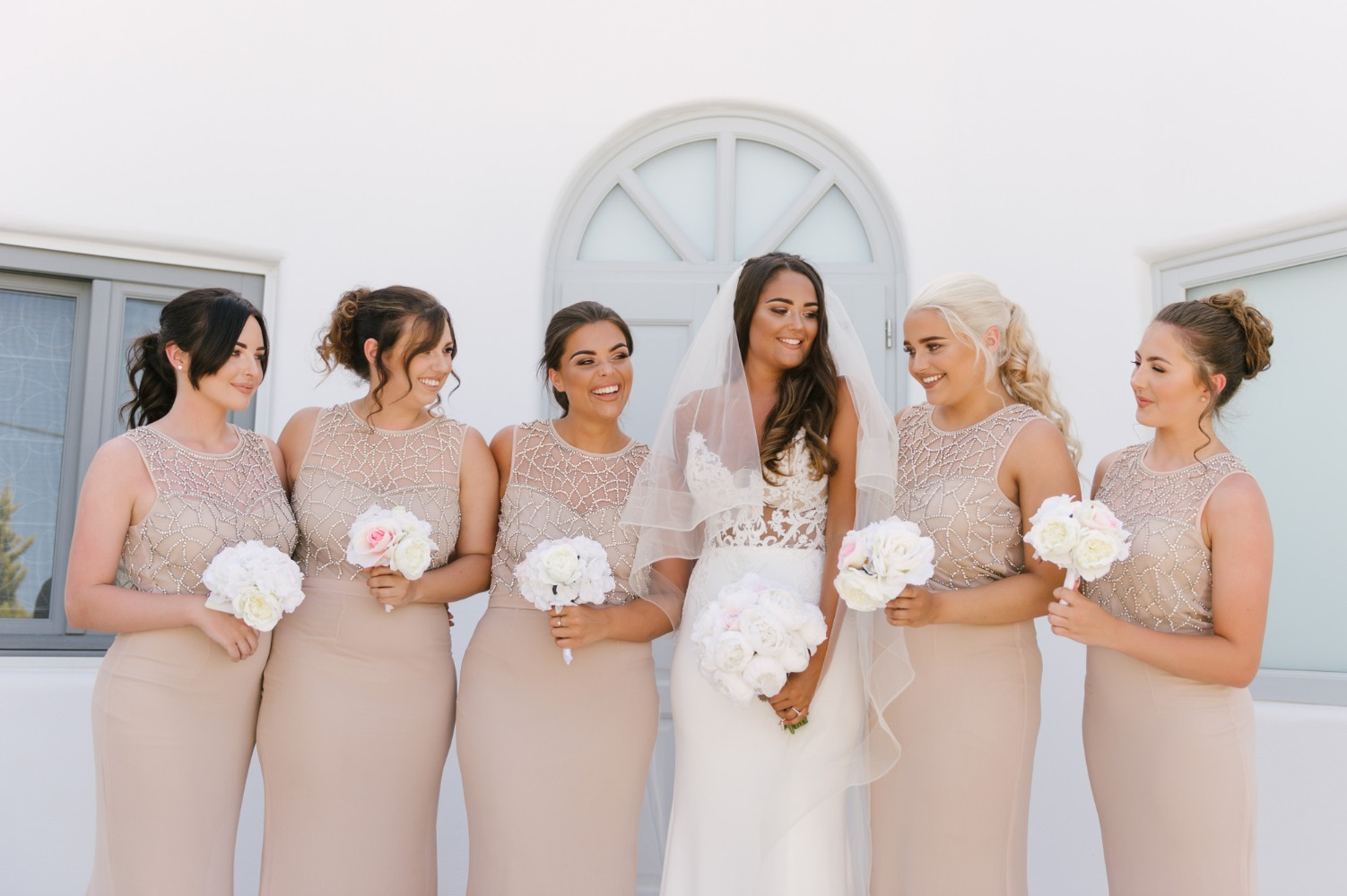 bridesmaids in sparkling champagne colored dresses