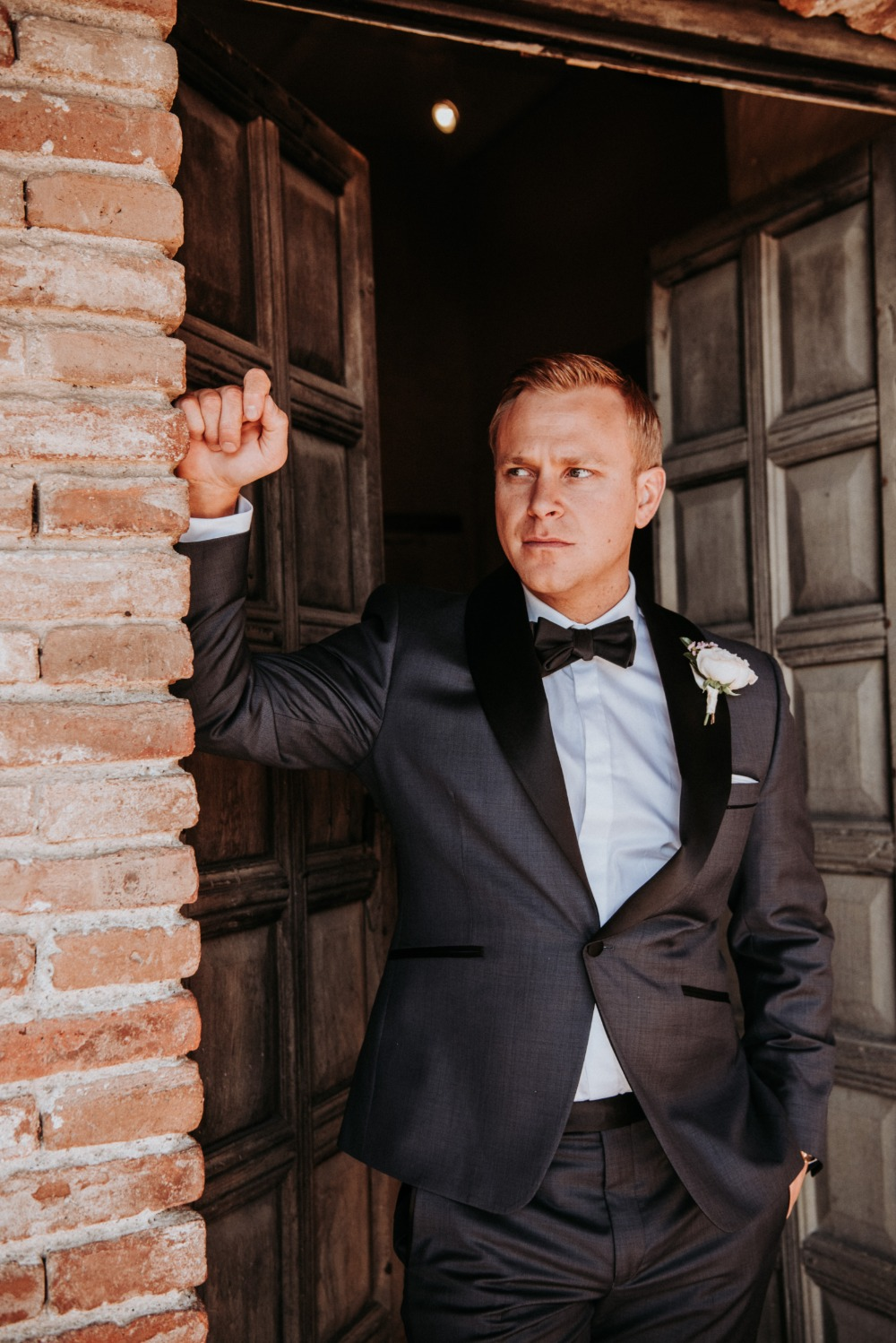 groom in sharkskin suit
