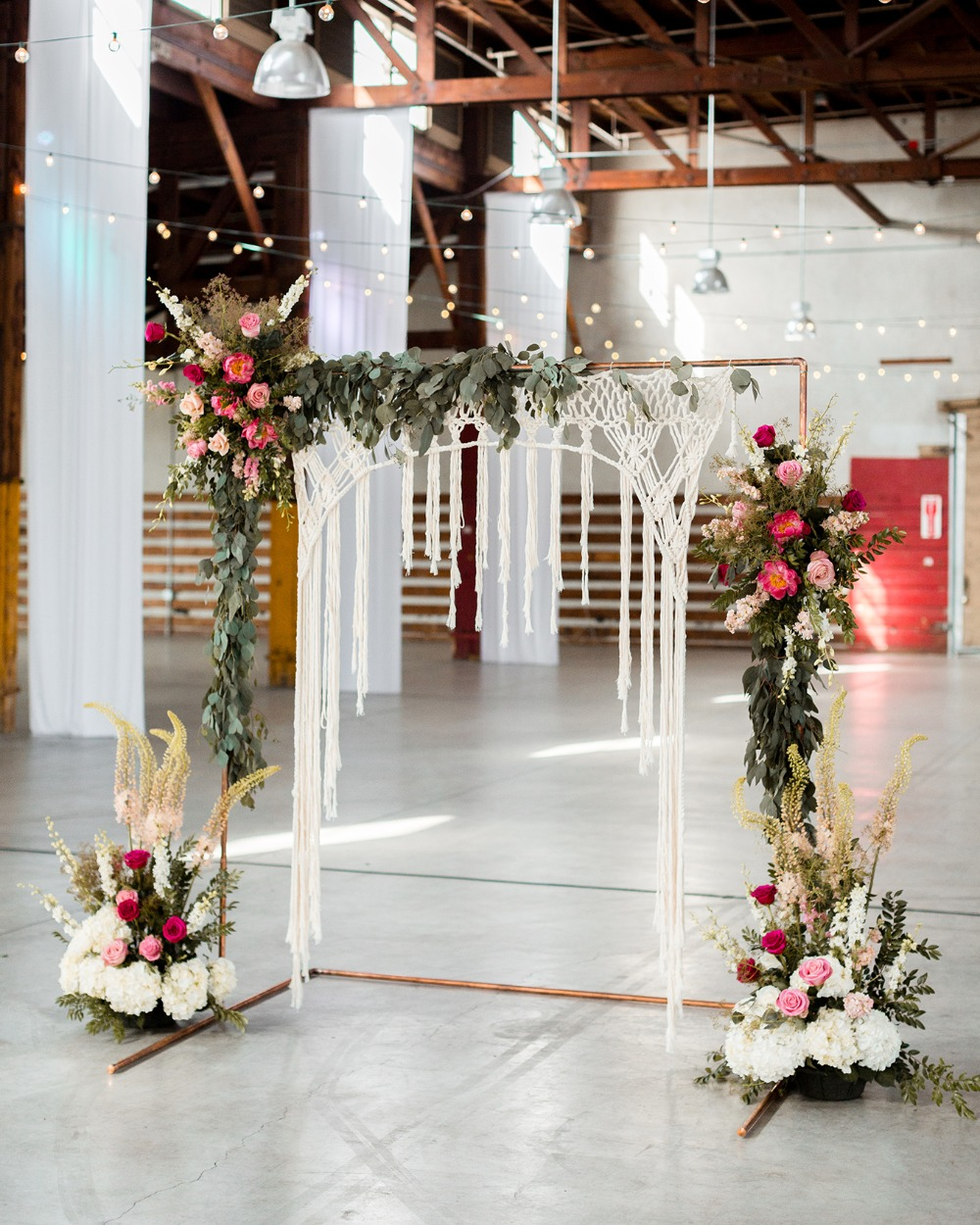 wedding arbor with macrame and florals