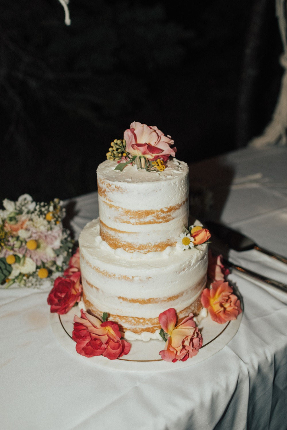 Naked cake with DIY florals added