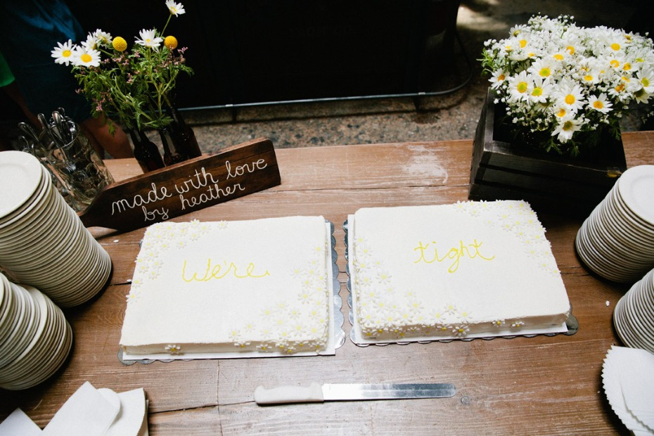 Bride and groom's wedding cake table - cakes say 'We're tight""