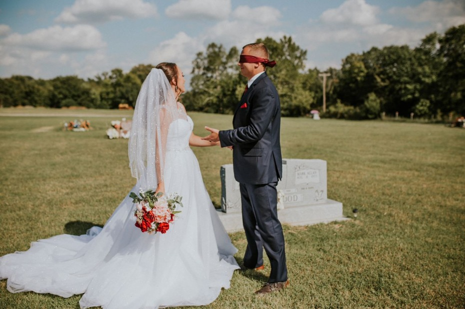 Bride surprising groom with first look at mother's gravesite