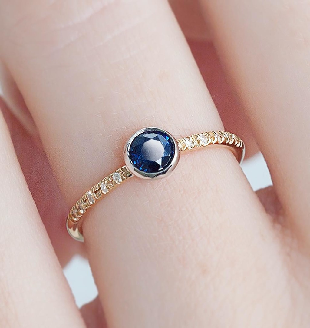 Dainty and Sweet Ethically Sourced Sapphire Ring made from reclaimed gold, sapphire, and diamonds.