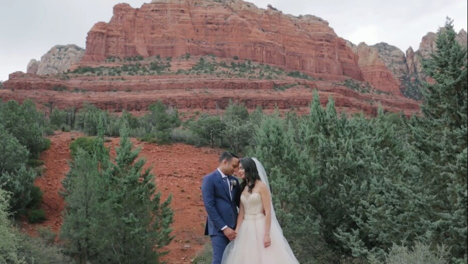 Bride and groom embracing at the bottom of a canyon