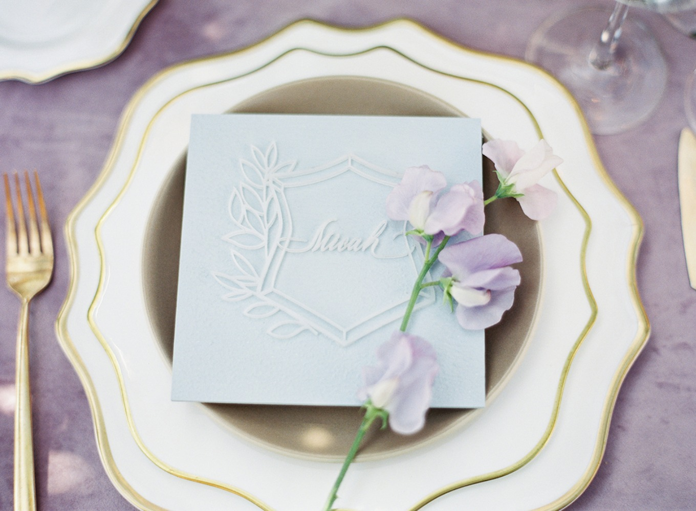 glam gold and lavender wedding place setting