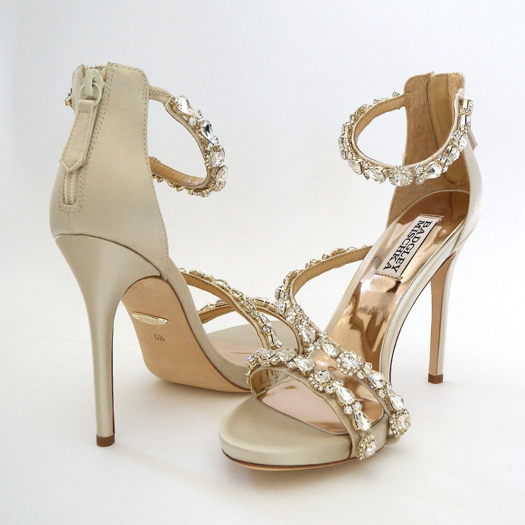 Sparkling footwear that brings on the glam! Rhinestone encrusted ivory silk straps featuring an asymetrical strap across the foot