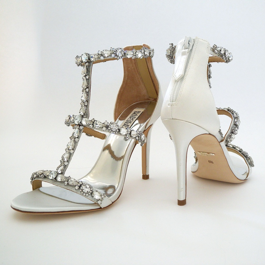 It's become a classic for Badgley Mischka. Rhinstone encrusted bridal sandal in silk white. Cnter T strap with a toe, center and