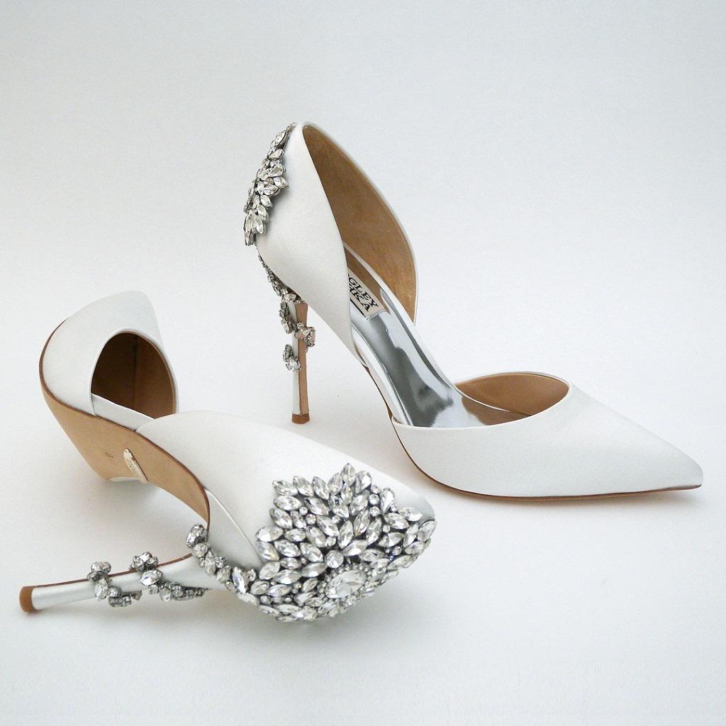 Strike a pose in these fabulous shoes! D'Orsay styling on a 3 3/4 heel. White silk satin, rhinestone ornament that wraps around