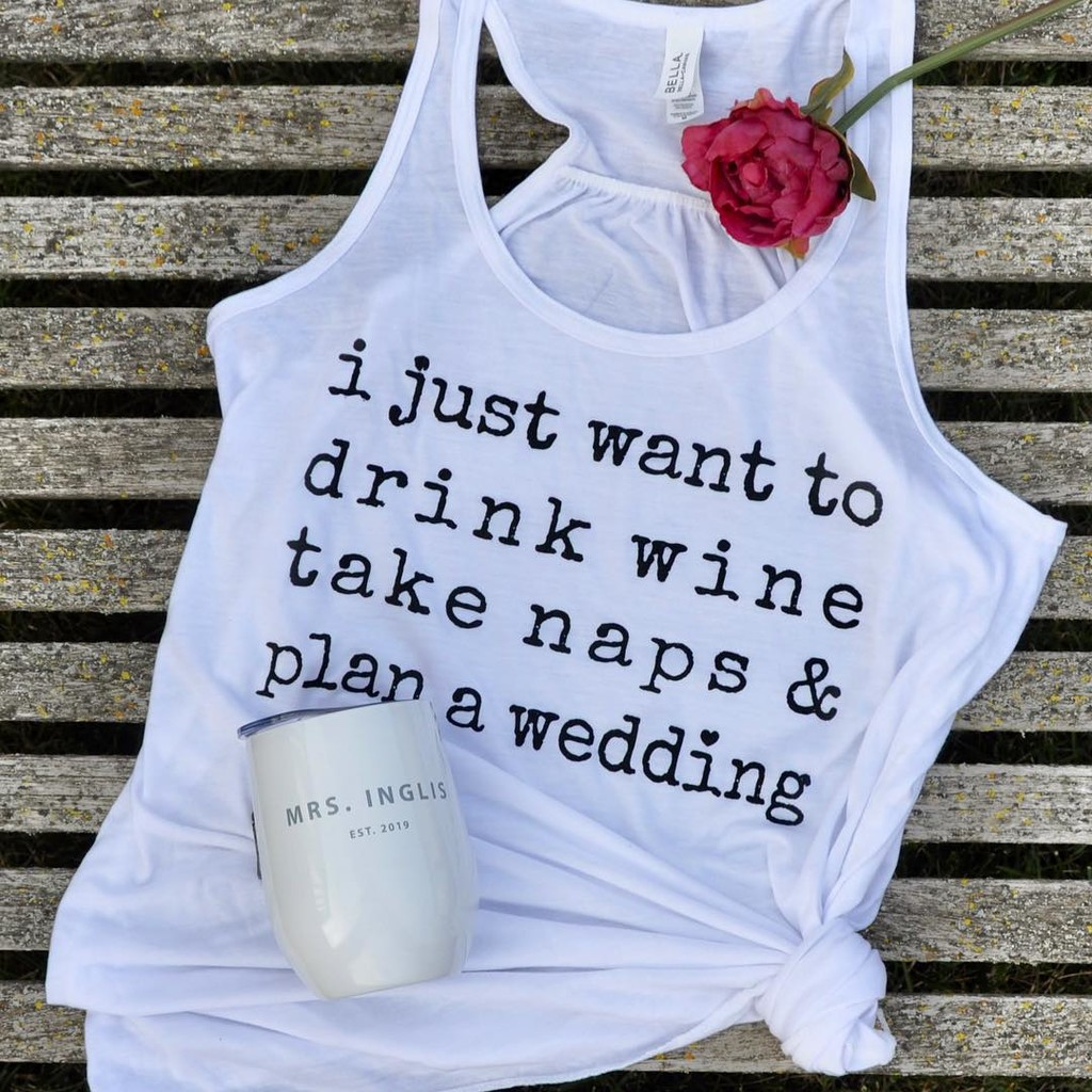 I like the wedding planner book idea as a gift too! It's just that...you can't wear a book...or sip from a book. (He he...I think