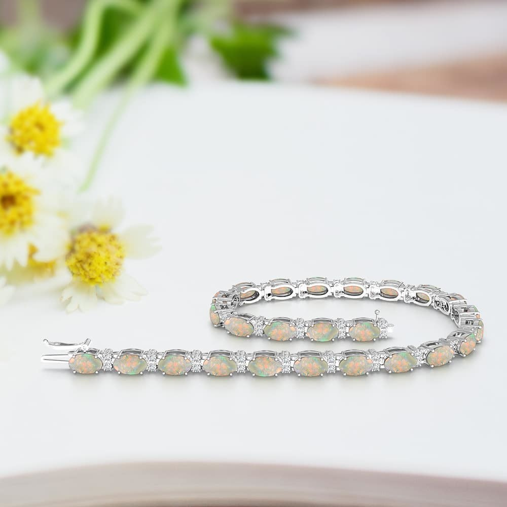 Galactic beauty of opals complemented by diamonds on this tennis bracelet.