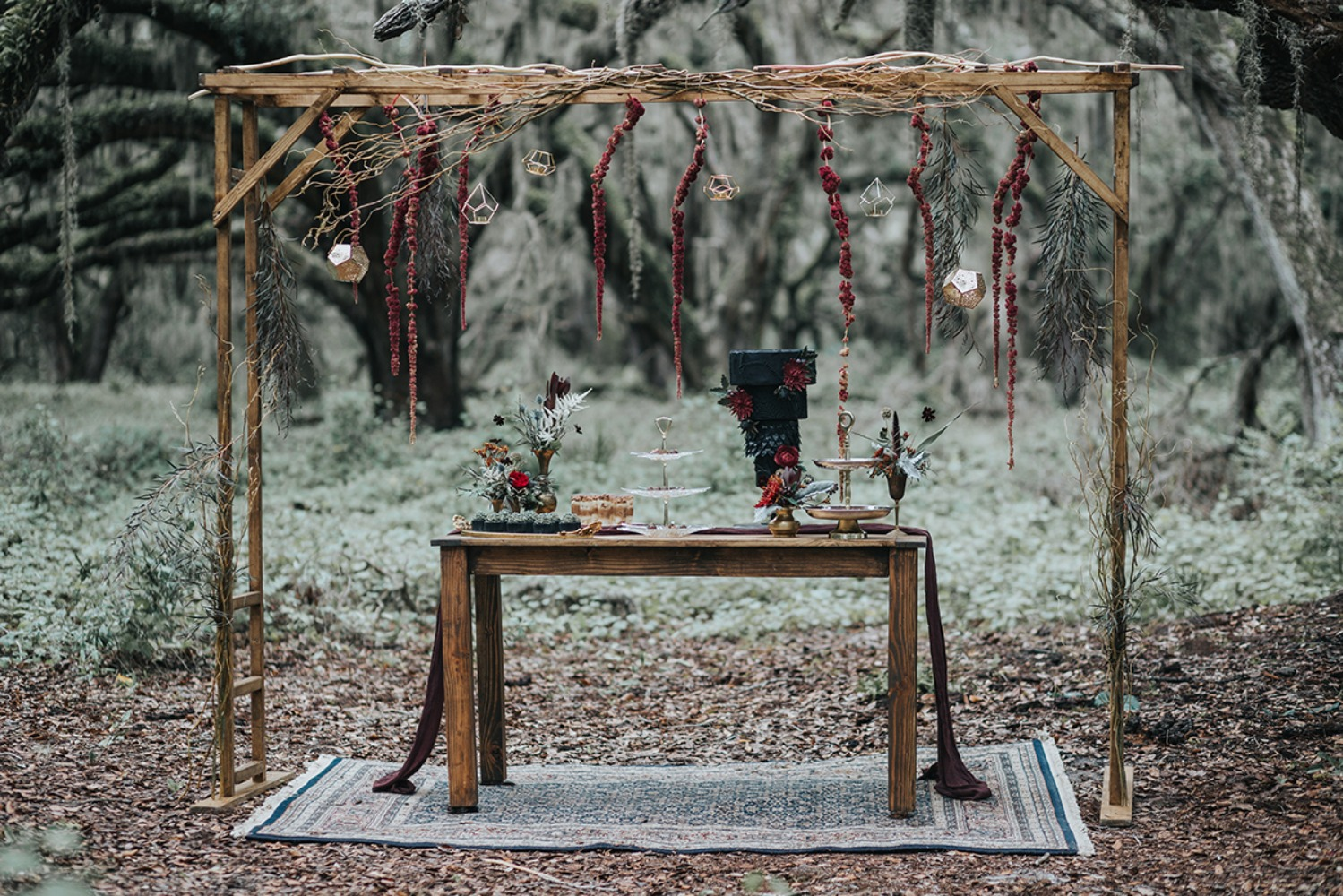 dark romance wedding dessert table