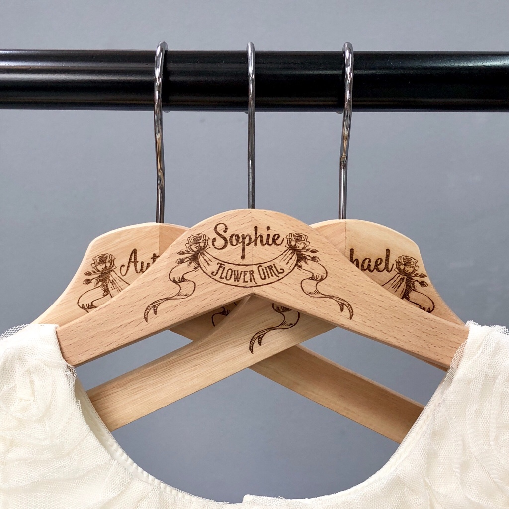 New! Smaller hangers for the flower 🌸 girls and jr. bridesmaids. ScissorMill engraves these natural wood hangers for the whole