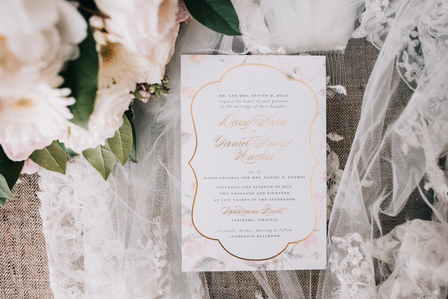 wedding invitation with flower and gold accents