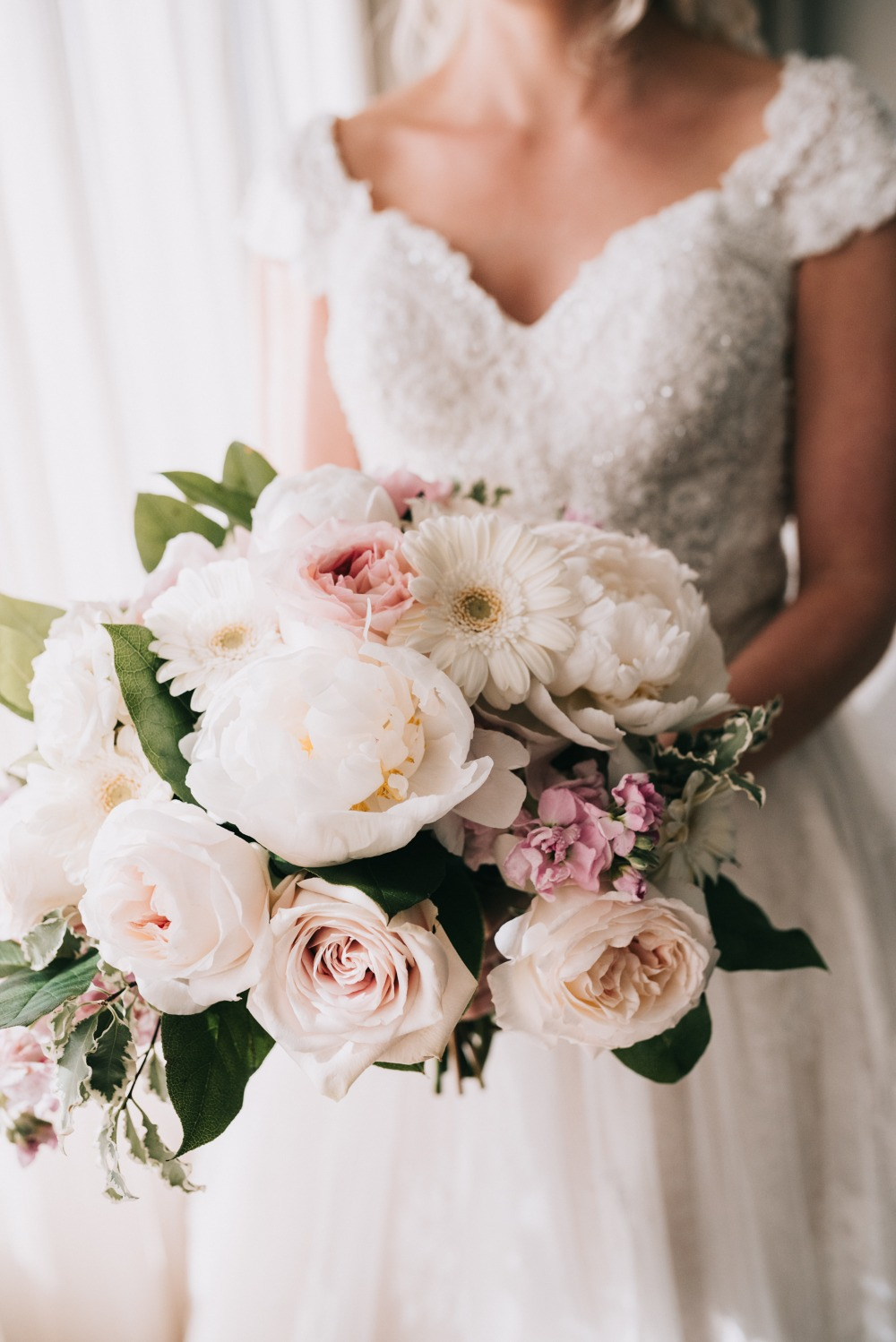 white wedding bouquet with a touch of pink