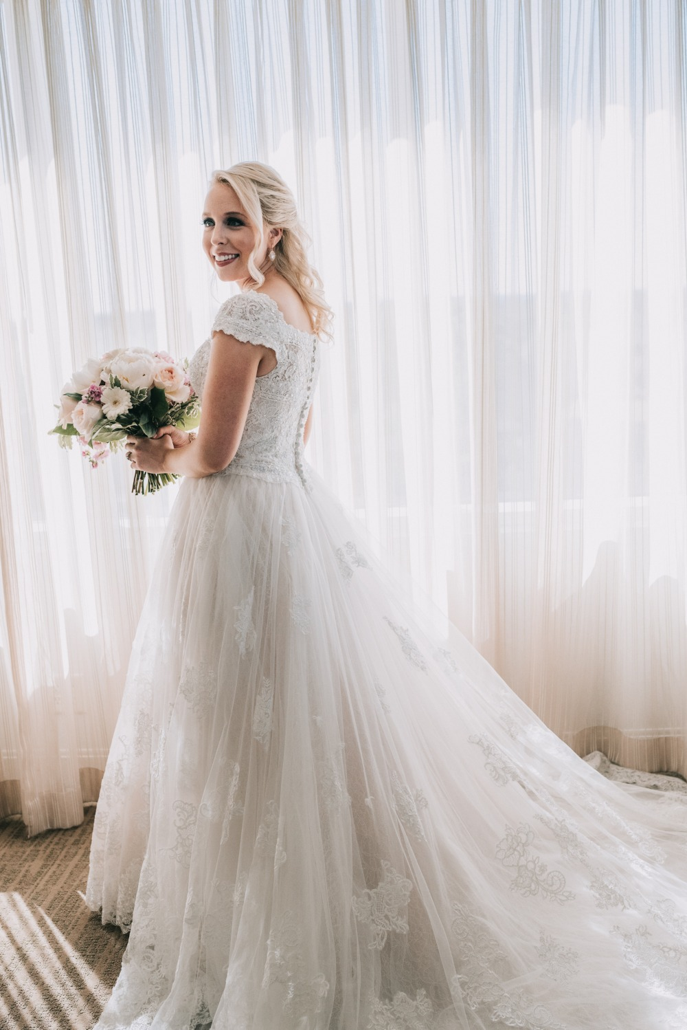beautiful bride in Oleg Cassini wedding dress