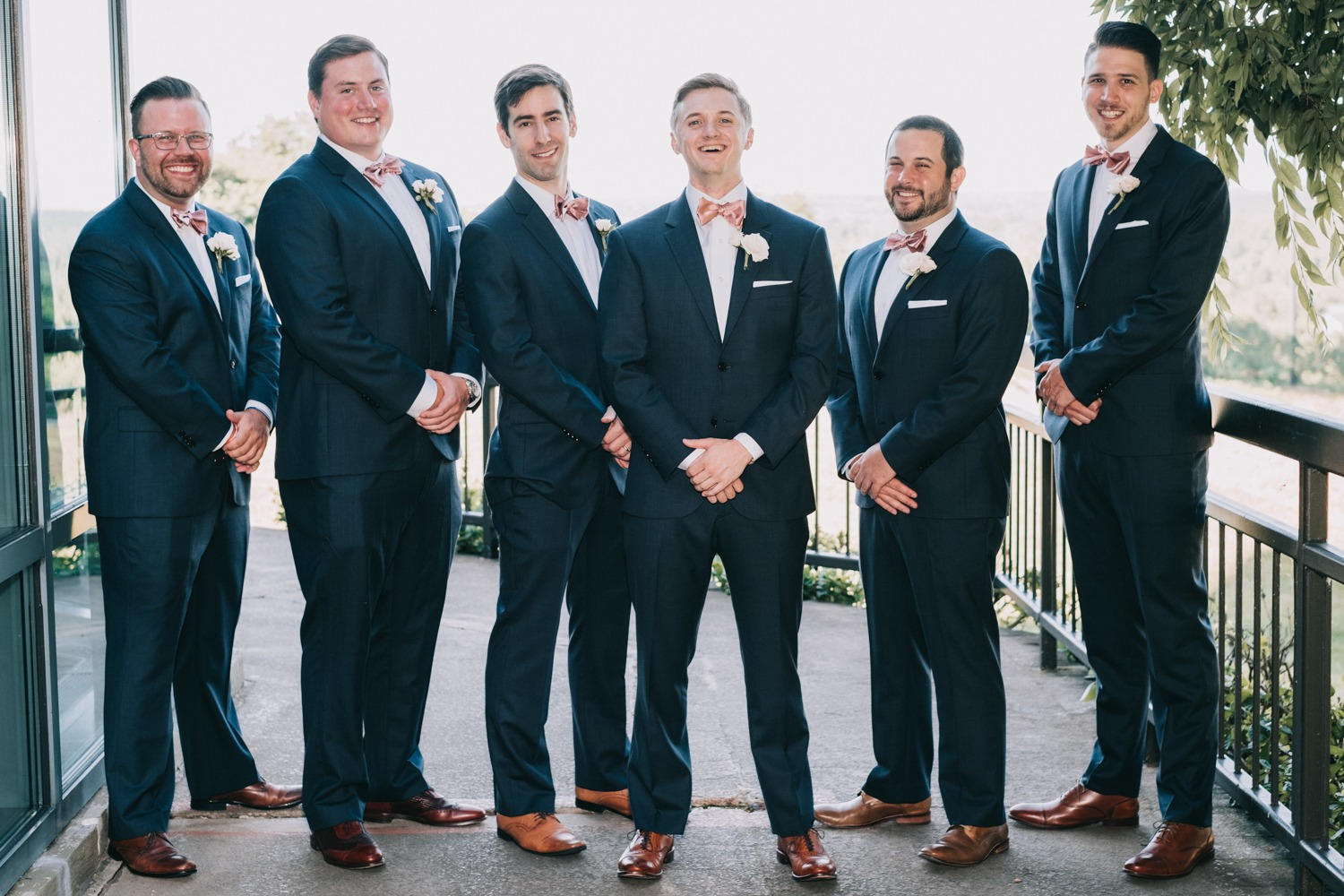 groom and his men in matching navy suits