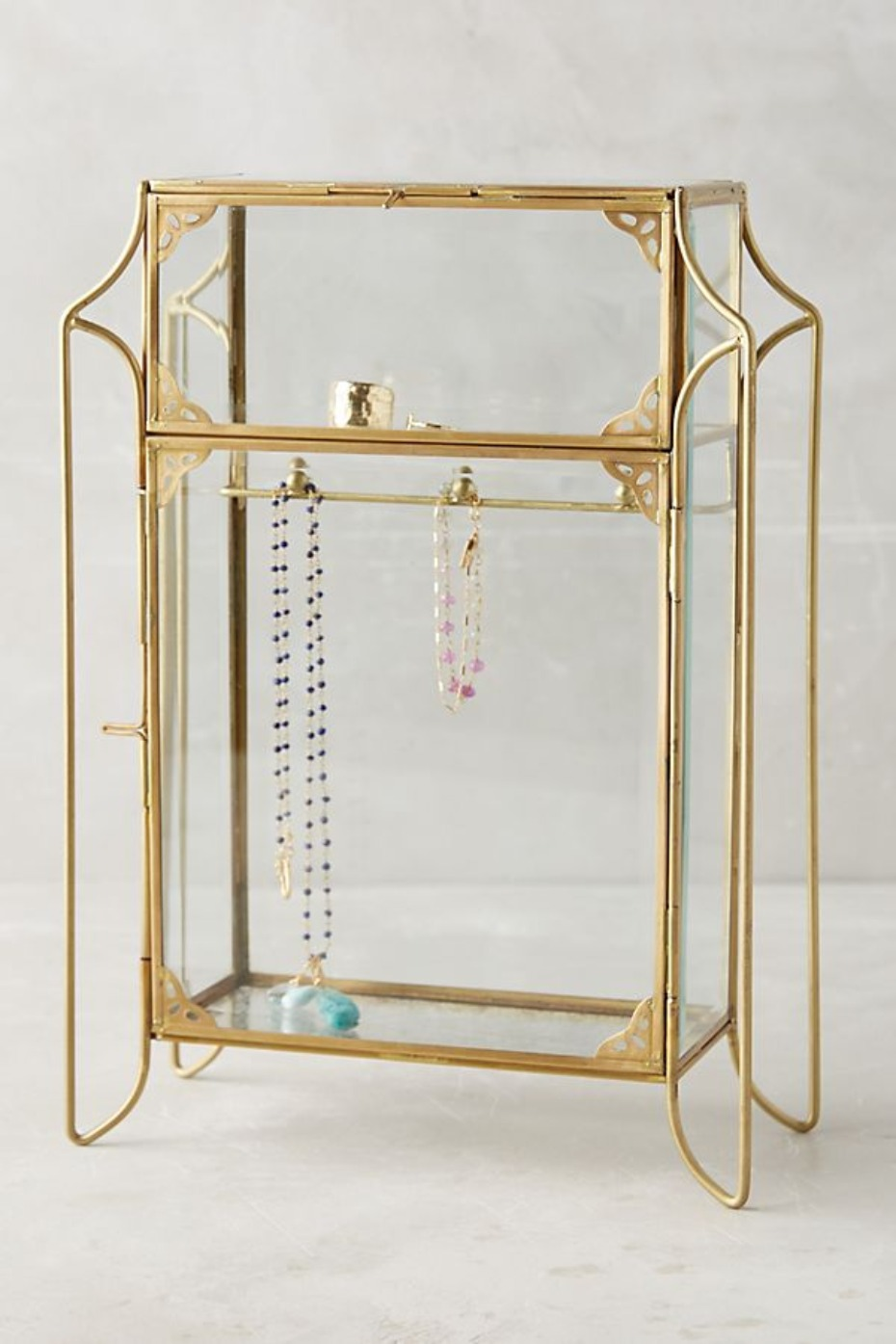 Standing jewelry cabinet glass