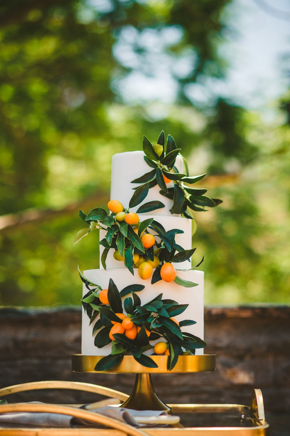 kumquat accented wedding cake