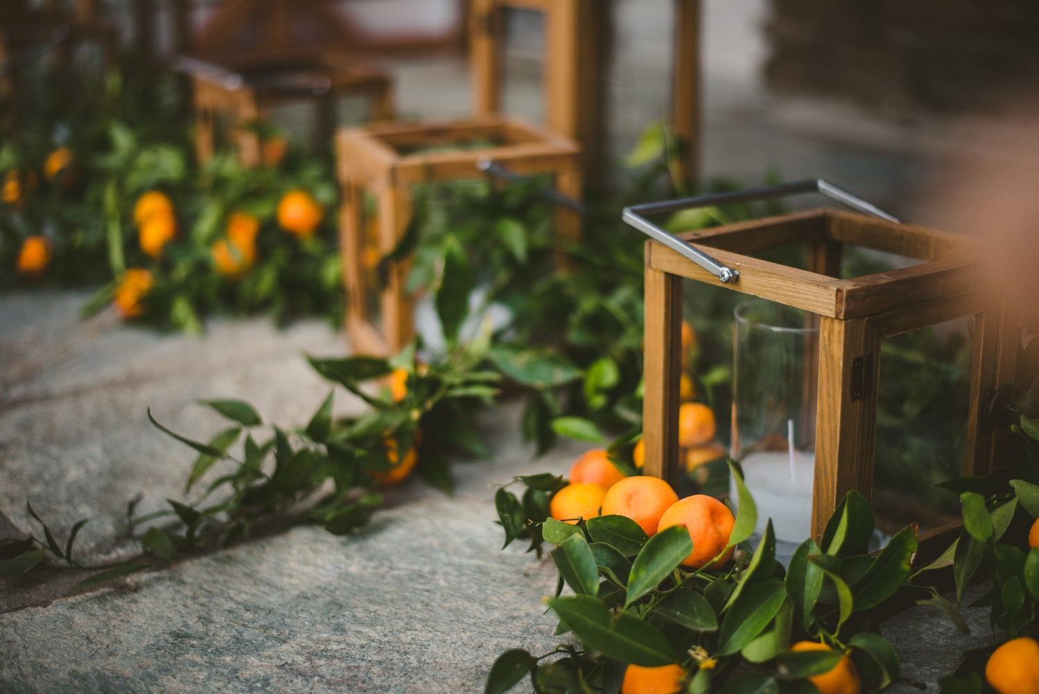 candle lanterns with kumquat accents