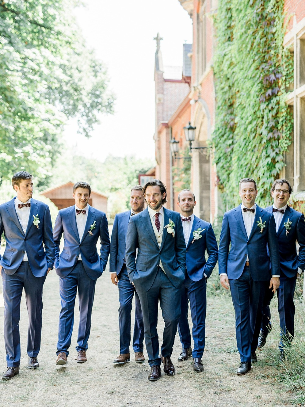 Navy blue suits for the groom and his men