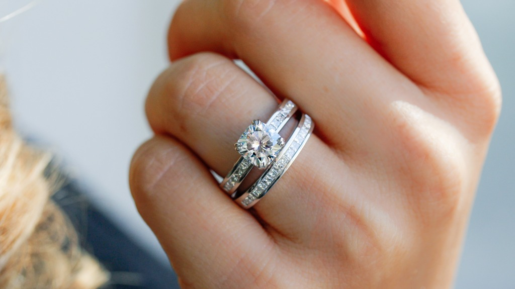 One of our favorite bridal sets, a cushion-cut moissanite and diamond ring 3 Carat (ctw) with a channel setting in 14k White Gold.