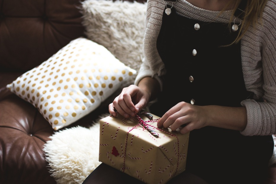 Woman sitting with Xmas present on lap
