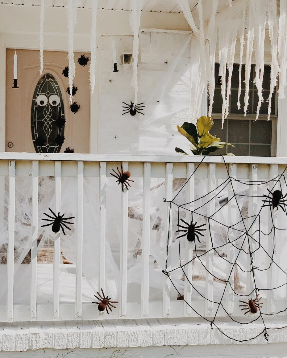 Autumn porch decorated with spiders
