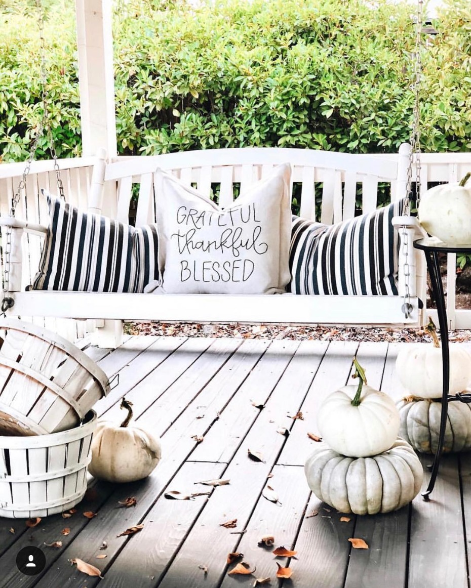 Black and white autumn porch with swing