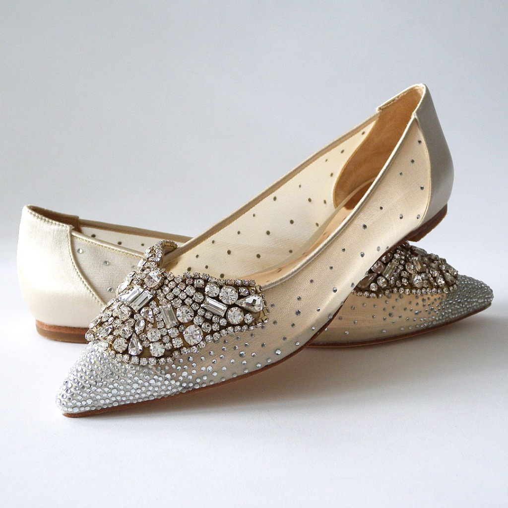 Sparkling flats you'll dance the night away in. Ivory wedding flats covered in sparkling rhinestones A scatter of crystals adorns