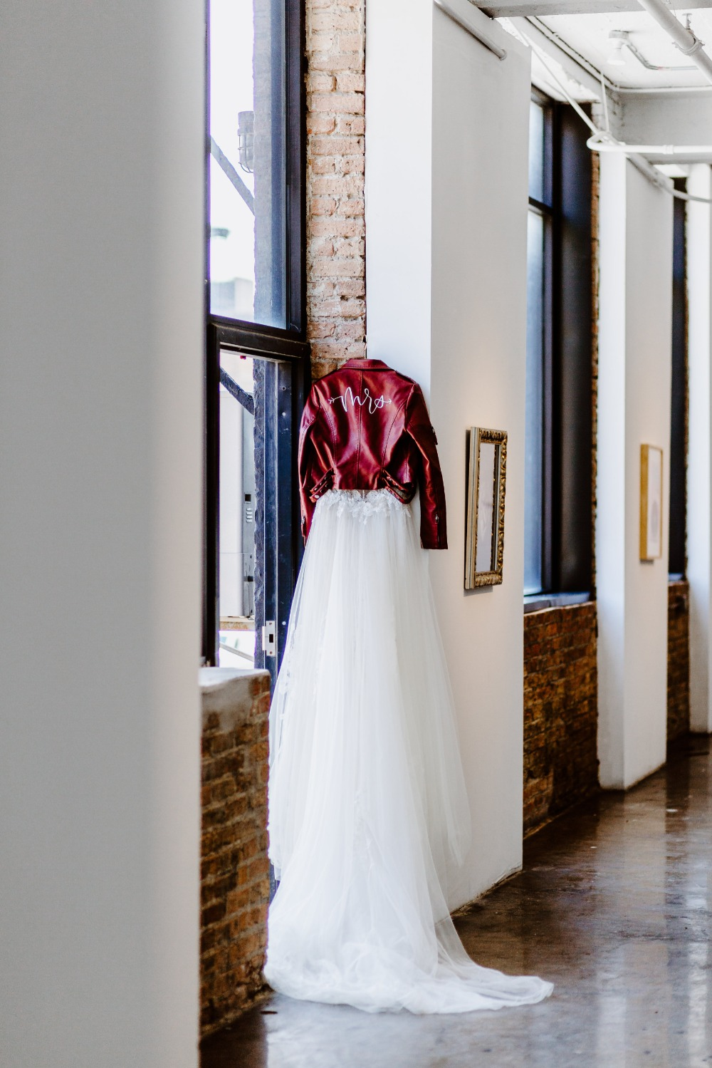 wedding dress and burgundy leather jacket