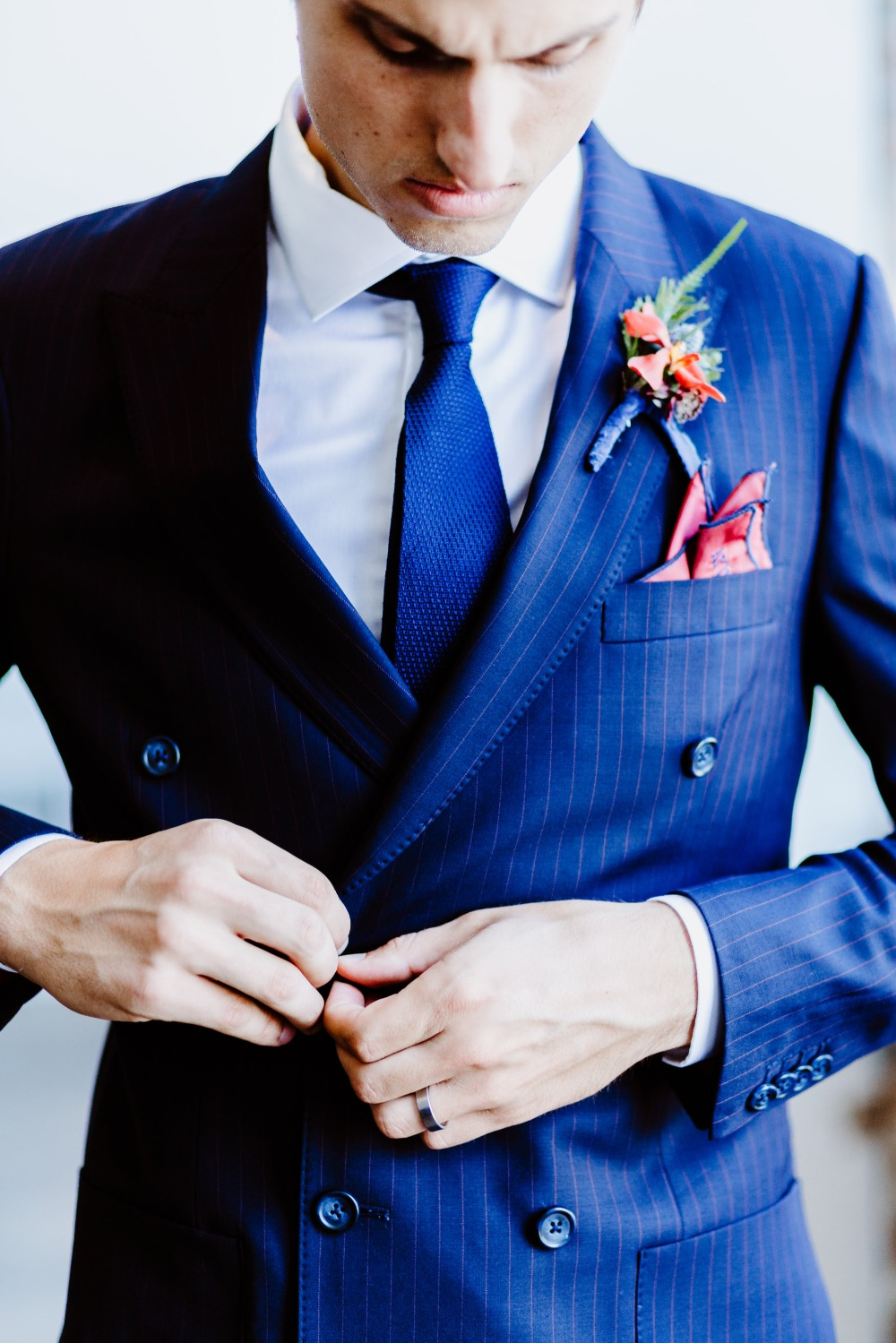 groom in navy double breasted pinstripe suit