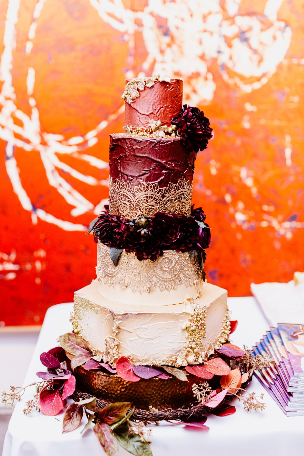 impressive burgundy and gold Moroccan inspired wedding cake