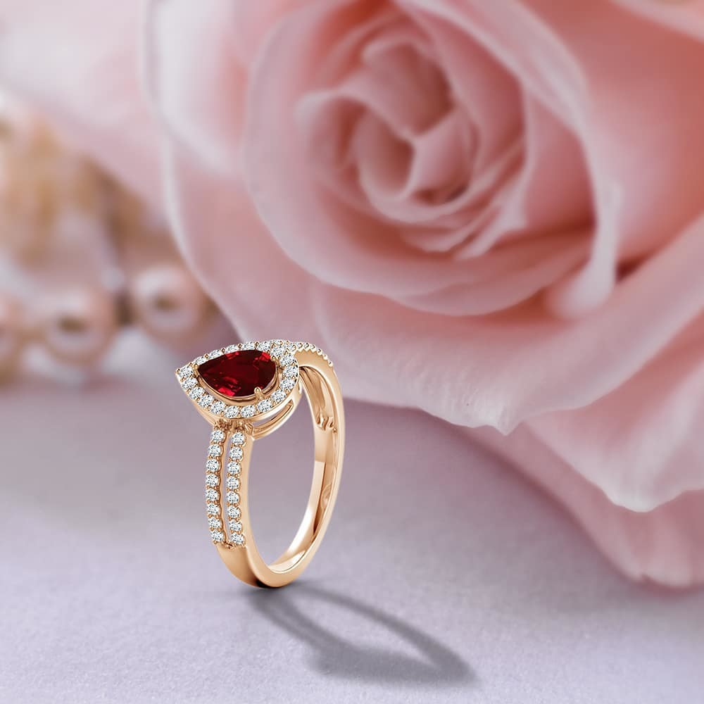 The pear #ruby, surrounded by a halo of diamonds, looks